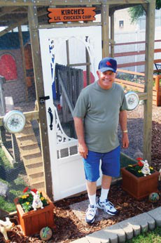 Dad, Norman Ford, modified the Little Tikes playhouse and built the run, saving money on a purchased coop.