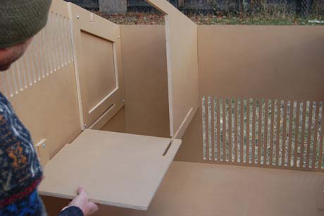 Just as assembly of the coop is easy, removing the roost, nest box base (shown), and coop floor makes maintenance a breeze.