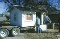 The Fouts loaded the old building onto a flatbed truck, and hauled it to the home site, below.