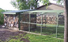 Using stone from the property ensures a coop that will last a lifetime. The firewood behind the coop offers another natural option for building a coop—cordwood building. A cordwood coop building instructions can be found in the book, Chicken Coops, by Judy Pangman. Another book on building with cordwood is Cordwood Building: The State of the Art by Rob Roy. Both books are available from the Backyard Poultry bookstore.